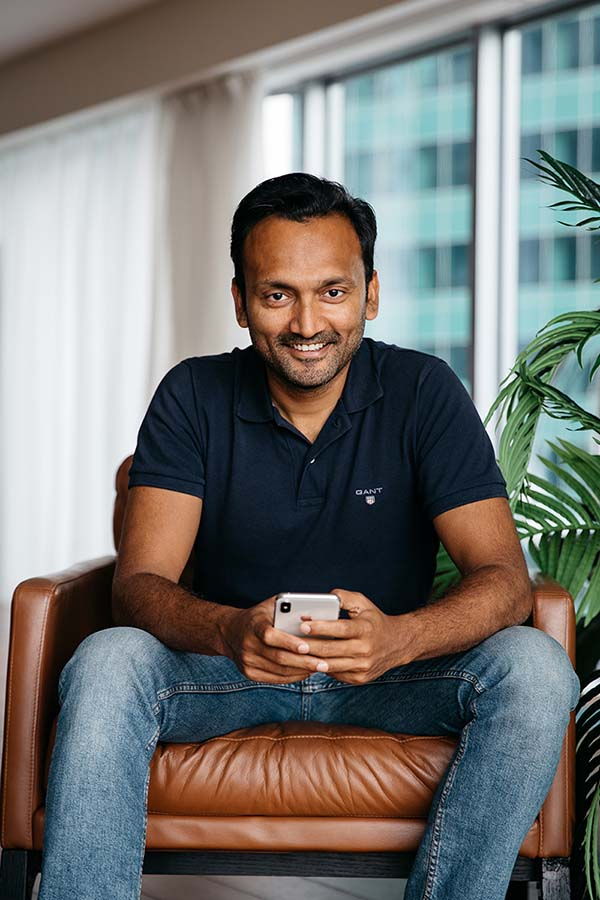 Photo of Gaurav Goel, founder of StayTouch, on a chair