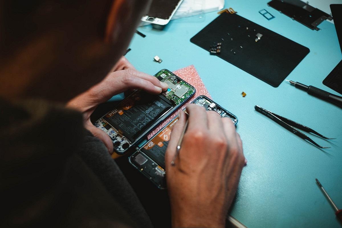 Person repairing a smartphone