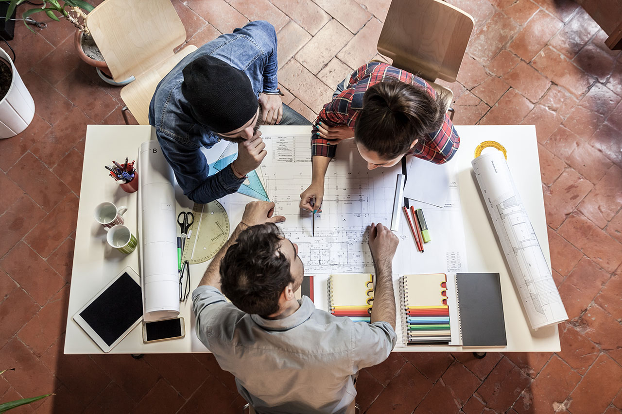 Teamwork. Three young architects working on a projec, ©loreanto / Adobe Stock
